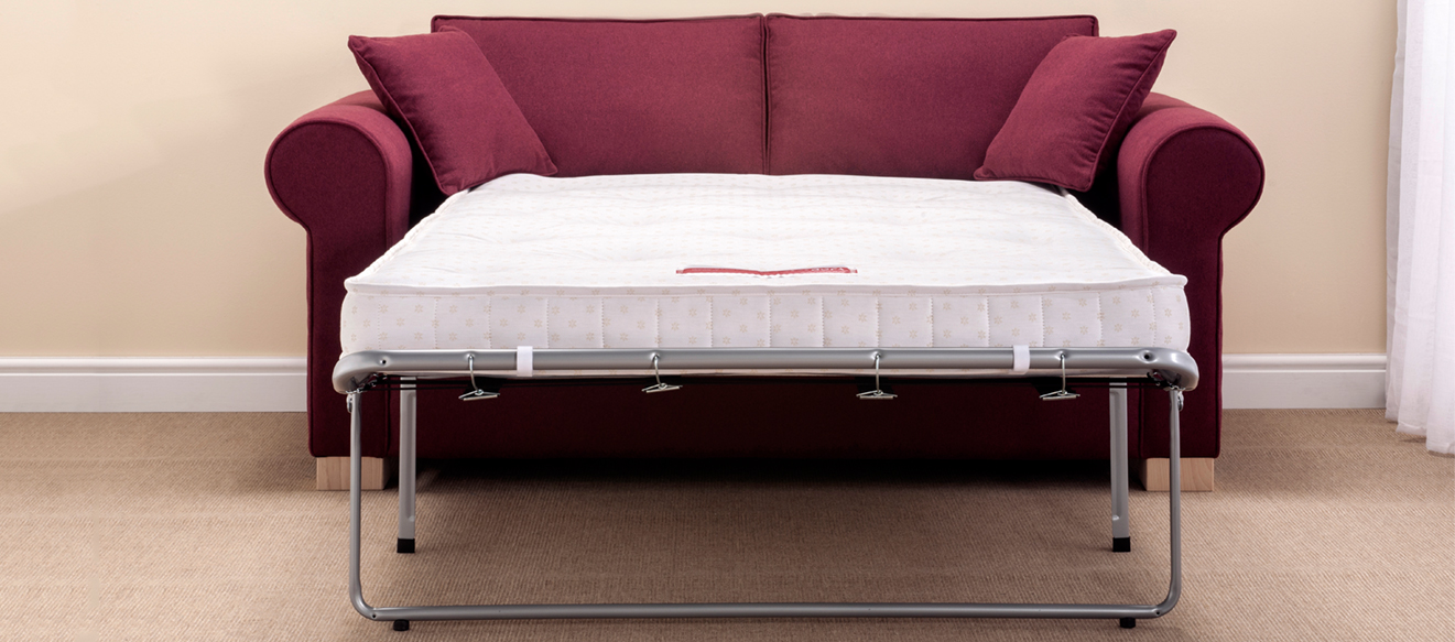 Cedar sofa bed upholstered in Proposta Aubergine