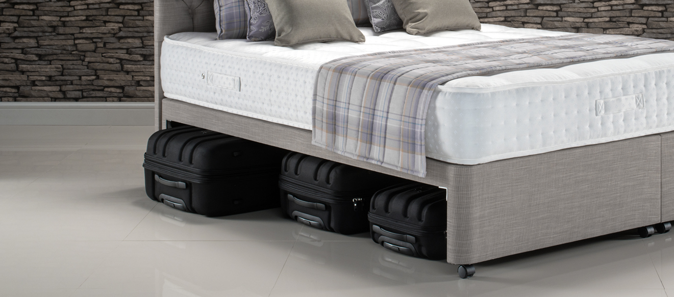 Suitcase storage option on a divan base